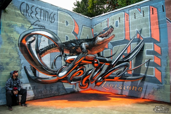 Odeith aligator stading on Anamorphic 3d chrome letters Greetings from Baton Rouge-s